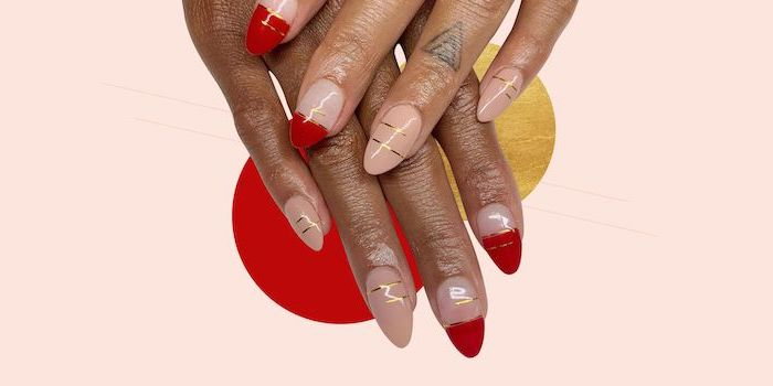 white and gold nails, french manicure with red nail polish, gold decorations on each nail, long almond nails