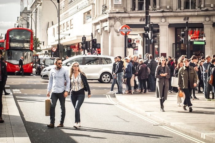 benefits of shopping, people walking up and down the street, oxford street london, oxford circus london