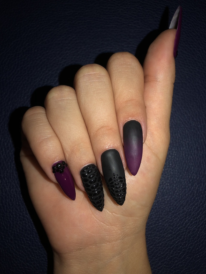 ombre nails, long stiletto nails, black and dark purple gradient nail polish, rhinestones decorations on middle ring and pinky fingers