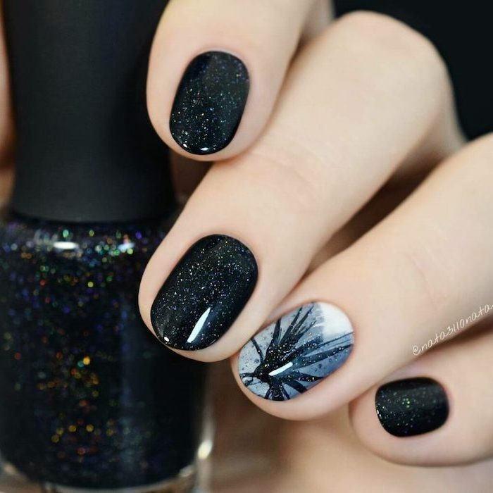 black glitter nail polish on short squoval nails, winter nail colors, grey and black decoration on the ring finger