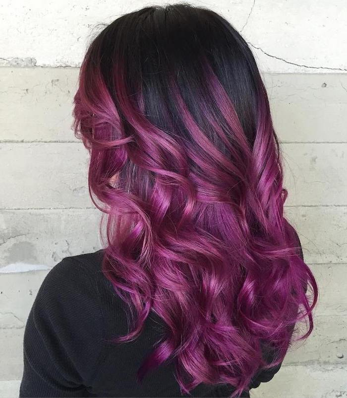 black hair with violet ombre effect, medium length wavy hair, woman wearing black blouse, curly hair color ideas