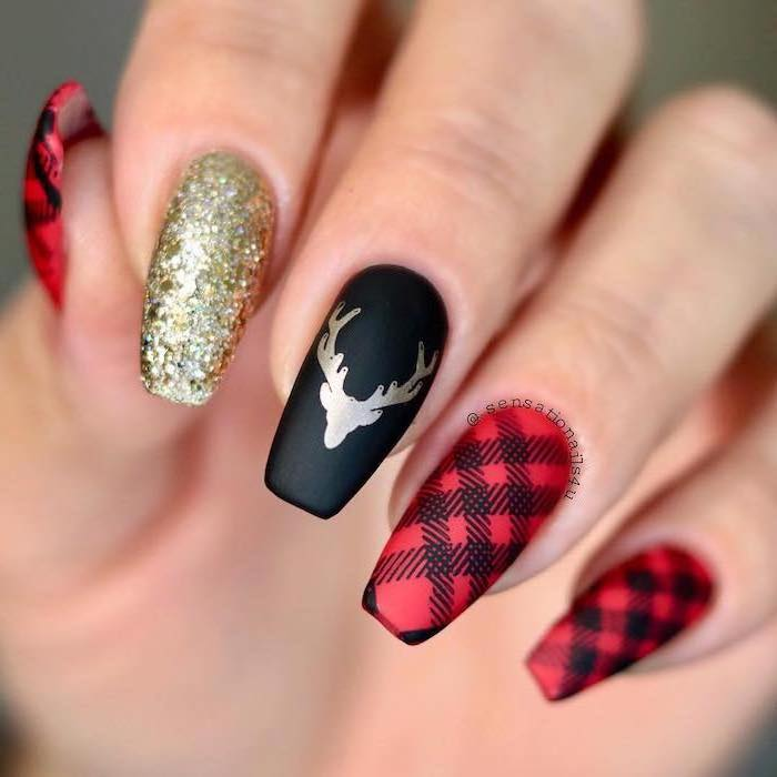 red and black matte nail polish, white and gold nails, plaid decorations, gold glitter and stag on index and middle finger