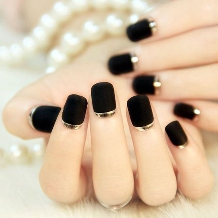 black matte nail polish with gold lines at the bottom, short squoval nails, white and gold nails