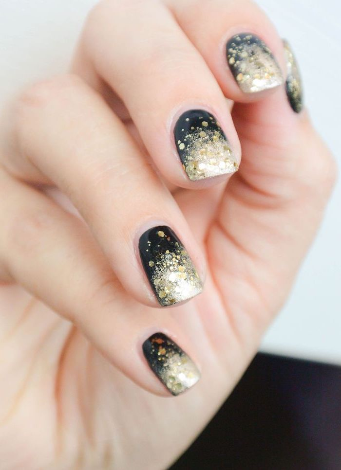 black to gold glitter nail polish, glitter ombre nails, short squoval nails, white background