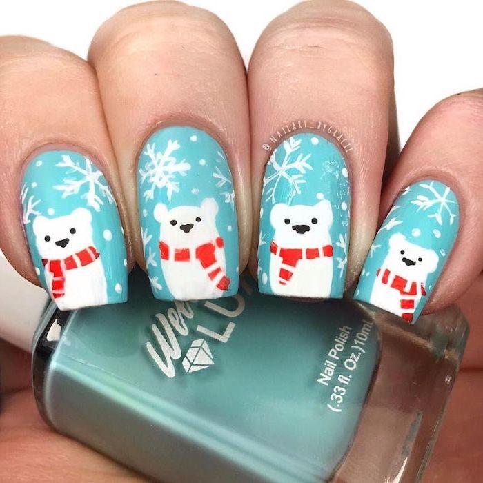 blue nail polish on short square nails, different color nails, polar bear decorations on each nail