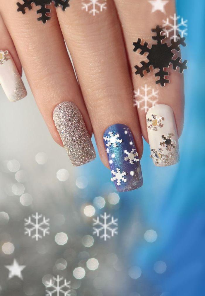 blue and white nail polish, silver glitter nail polish, nail colors, snowflakes decorations on the nails