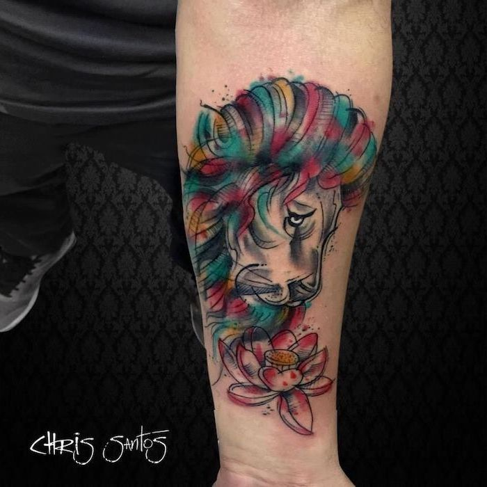 watercolor forearm tattoo, lioness tattoo, profile of lion head, watercolor mane in different colors, watercolor lotus flower