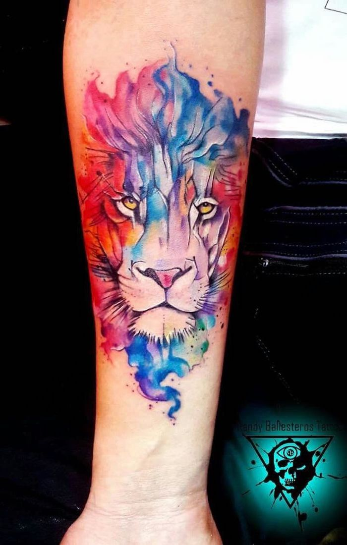 watercolor forearm tattoo, lion forearm tattoo, lion head in blue pink red purple and green, different colors