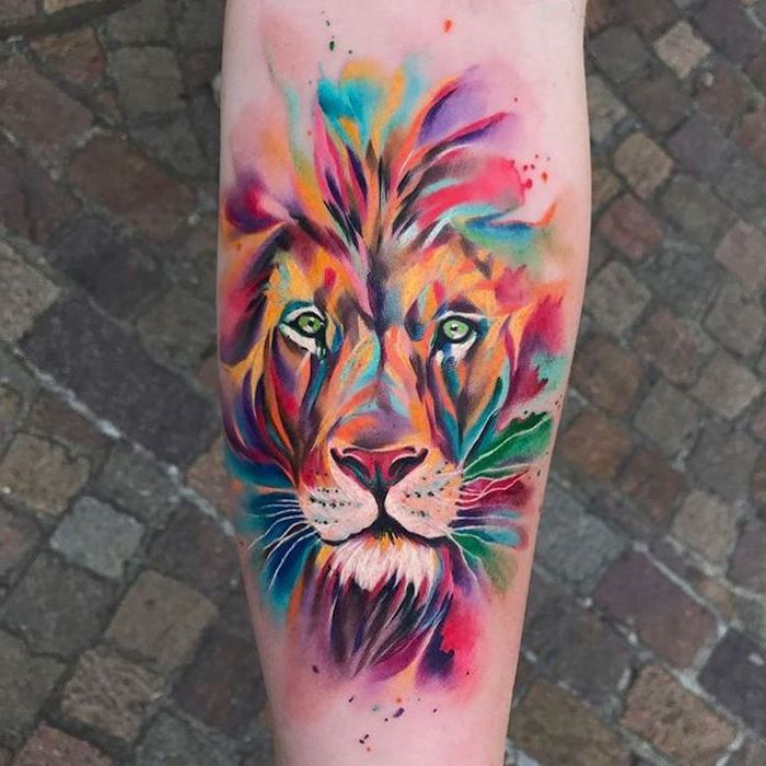 watercolor back of leg tattoo, lion tattoo, lion head with mane in different colors, paved street in the background