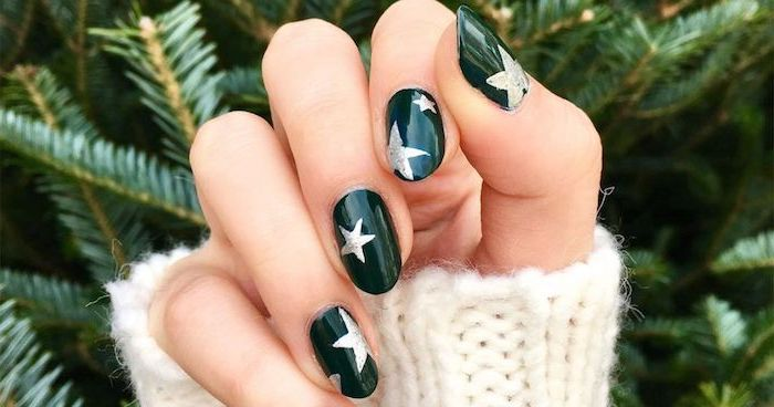 almond shaped nails, nail color ideas, green nail polish with silver glitter stars, star decorations on each nail