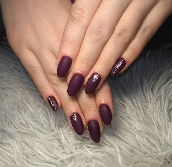 dark burgundy nail polish, neutral nail colors, long almond nails, silver glitter decorations on pinky and ring finger