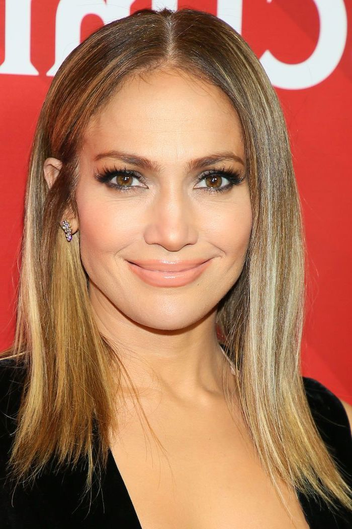 jennifer lopez wearing black dress, balayage caramel brown hair with blonde highlights, fall hair colors for blondes