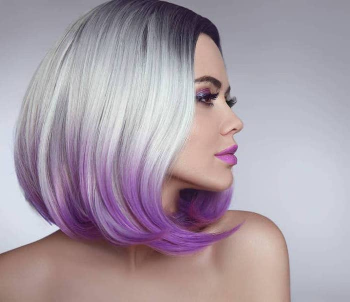 woman with short straight bob, dark to light grey to purple ombre effect, hair color for women over 50