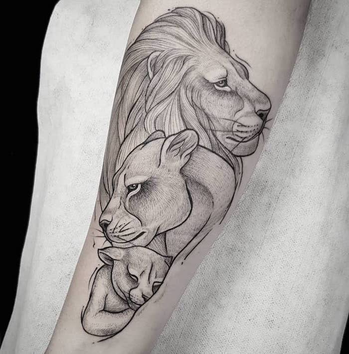 family of lions, lion and lioness with their cub, lion chest tattoo, forearm tattoo, white background
