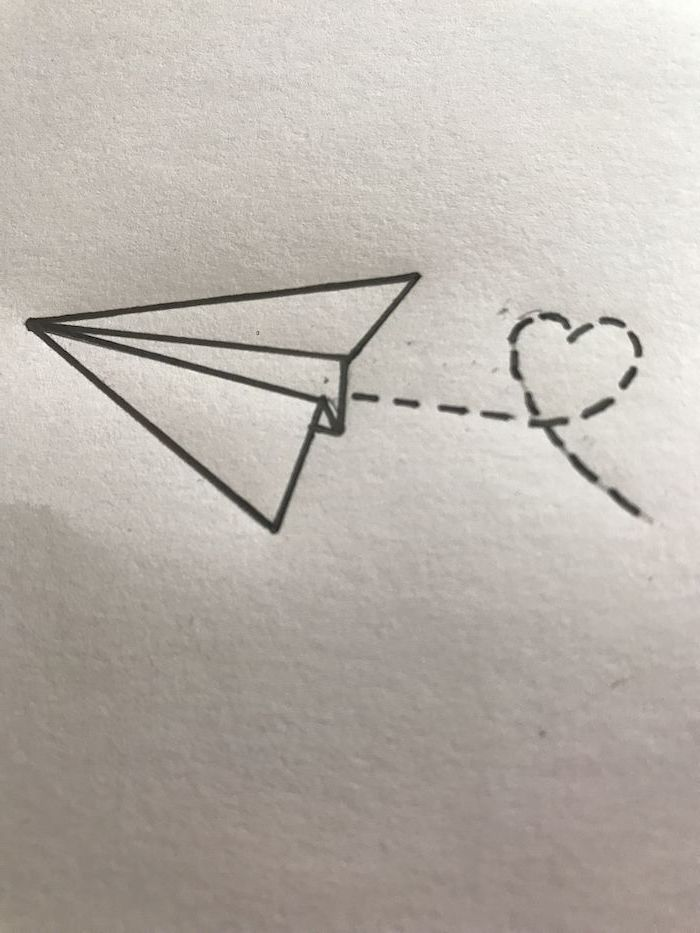 cute things to draw, flying paper plane, leaving a heart shaped trace behind it, black and white pencil sketch