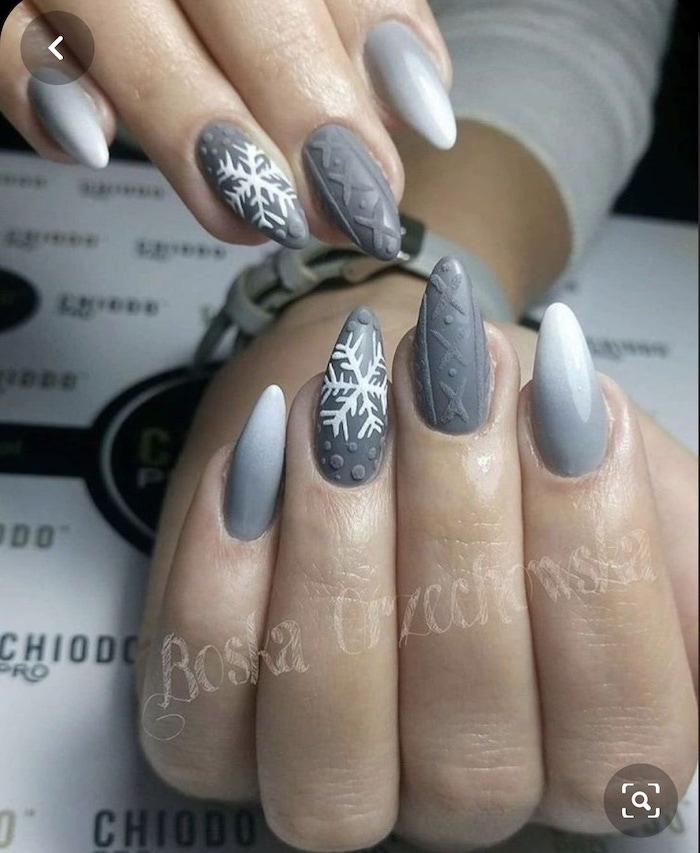 winter nails, medium length stiletto nails, ombre acrylic nails, white to grey gradient nail polish, decorations on ring and middle fingers