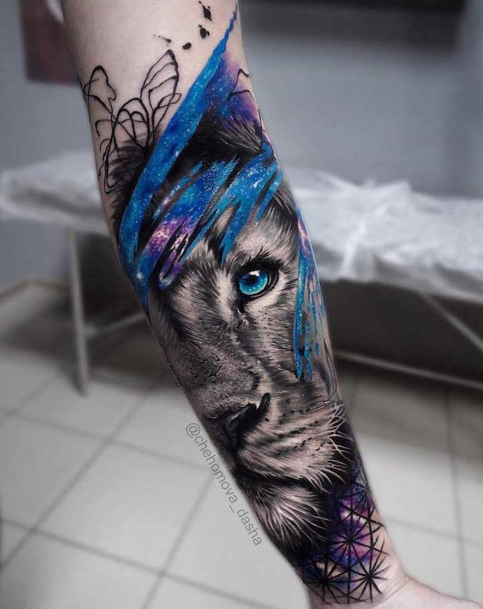 lion head with blue eyes, surrounded by galaxy, watercolor forearm tattoo, lion chest tattoo, blurred background