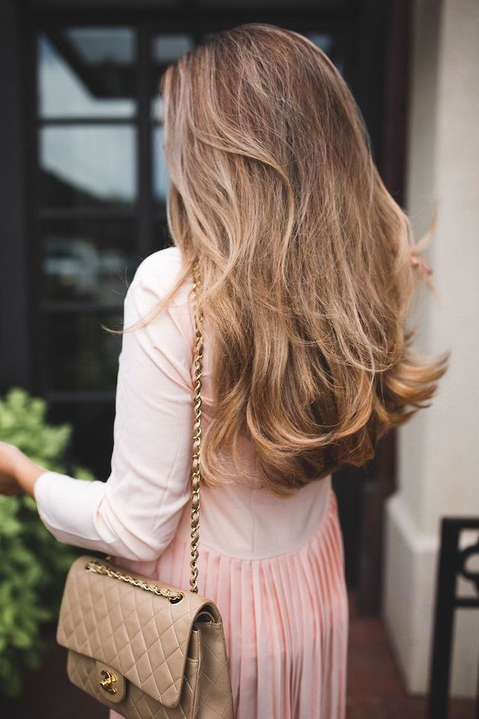 woman wearing pink dress, brown leather cross body bag, hair color trends fall 2020, long wavy hair, brown with highlights