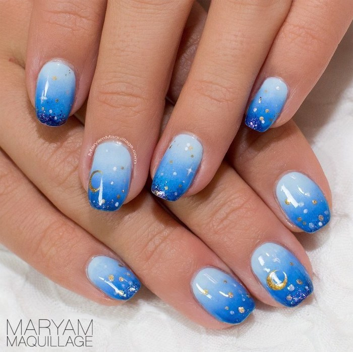 light to dark blue gradient nail polish, pink and white ombre nails, decorations with stars and moon on each finger