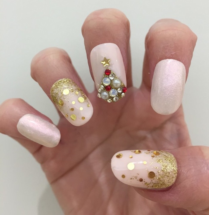 white glitter nail polish, pretty nail colors, gold glitter on thumb and ring finger, rhinestone christmas tree on middle finger