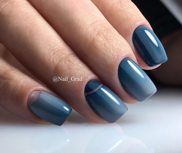 winter nails, gradient shades of blue nail polish, short squoval nails, hand placed on white surface