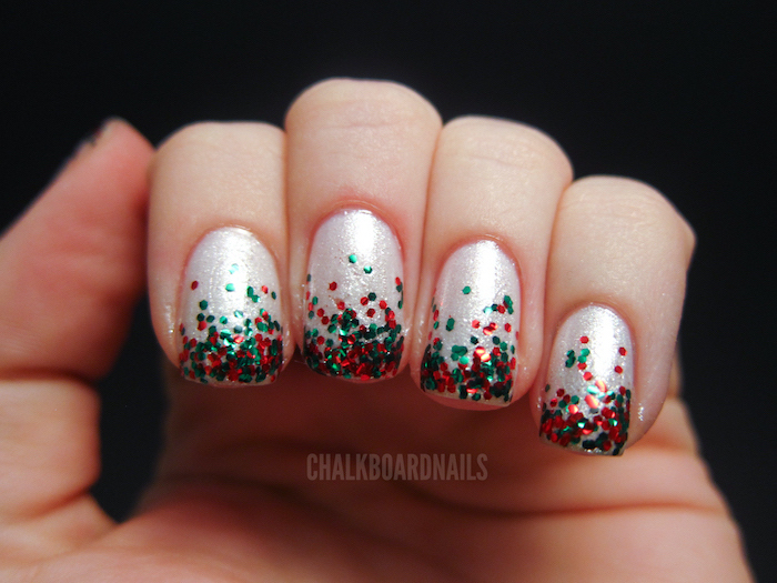 white glitter nail polish, pretty nail colors, short squoval nails, green and red glitter decoration on each nail
