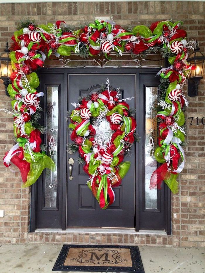 wreaths made of green and red ribbons and baubles, hanging on door and door frame, front porch christmas decorations