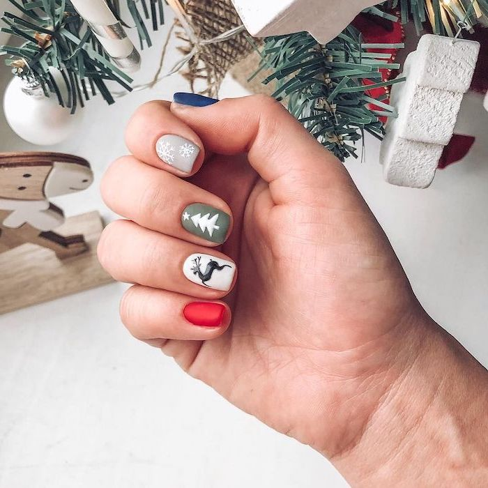 red white green grey and blue matte nail polish, short nails with different decorations on each nail, pretty nail colors