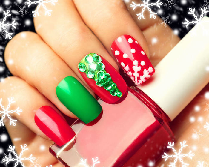 green and red nail polish, pretty nail colors, green rhinestones christmas tree on middle finger, snowflakes on index finger
