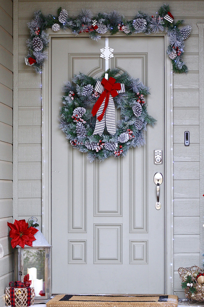 diy outdoor christmas decorations, wreaths with snowy pinecones and red ribbon, hanging over door and door frame