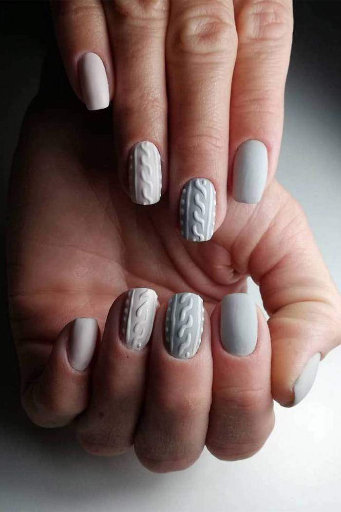 grey and white matte nail polish, winter nail designs, decorations on the middle and ring fingers