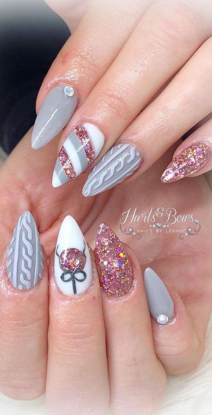 white and grey nail polish, winter nail designs, pink glitter nail polish, different decoration on each nail