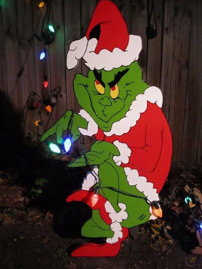 grinch figurine made out of carton, colorful lights around it, diy outdoor christmas decorations, placed in the front yard