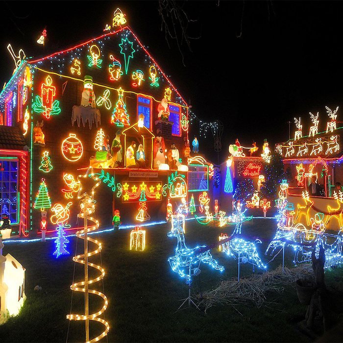 front door christmas decor, large two storey house, covered with lighted figures, lighted figurines in the back yard
