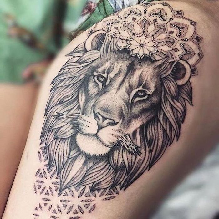 lion head with mandala flowers, lion king tattoo, thigh tattoo, blurred background
