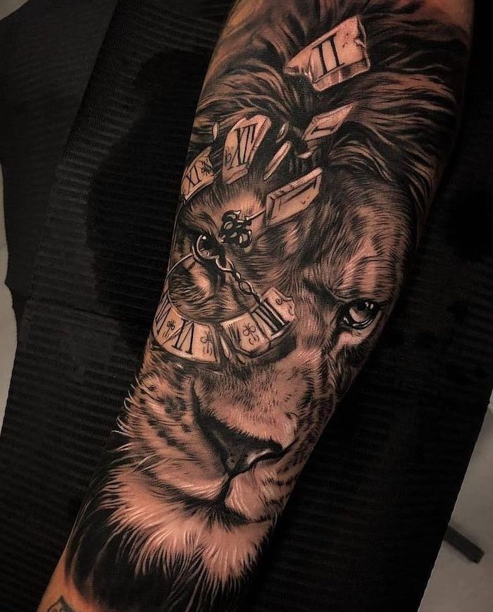 forearm tattoo, lion tattoo meaning, lion head with a broken clock with roman numerals, black background