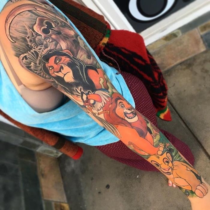lion king inspired sleeve tattoo, lion shoulder tattoo, mufasa scar and simba, colored sleeve tattoo