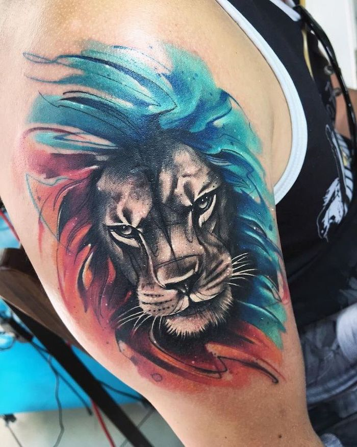lion sleeve tattoo, watercolor shoulder tattoo, angry lion with mane, colored in blue and red