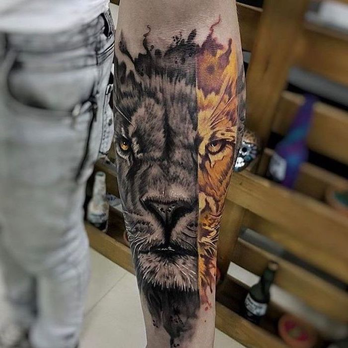 lion head, one half in black and white, other half in yellow and orange, lion sleeve tattoo, forearm tattoo