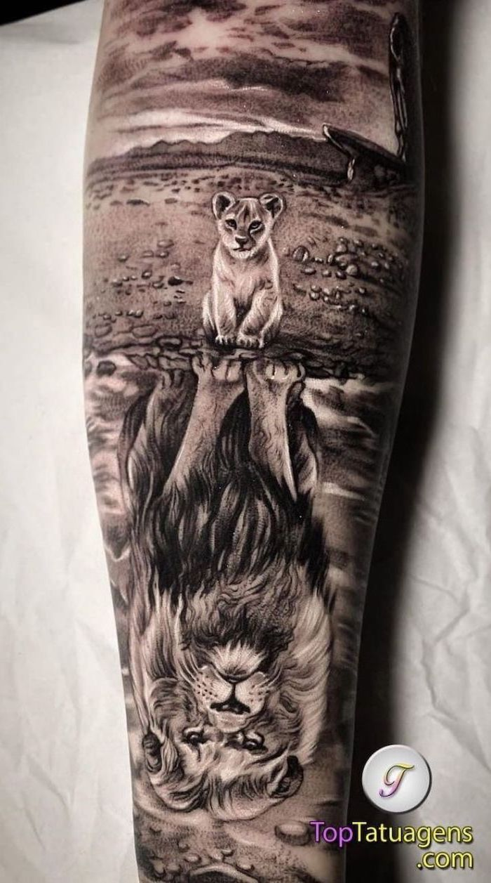 small lion cub, looking at its reflection in the water, large lion in the water, lion sleeve tattoo, back of leg tattoo