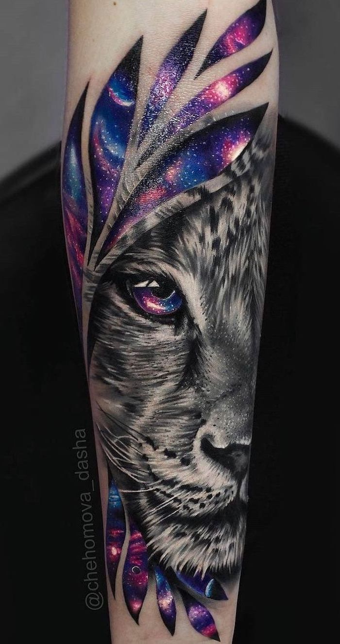 lioness head, surrounded by watercolor galaxy, forearm tattoo, lion with crown tattoo