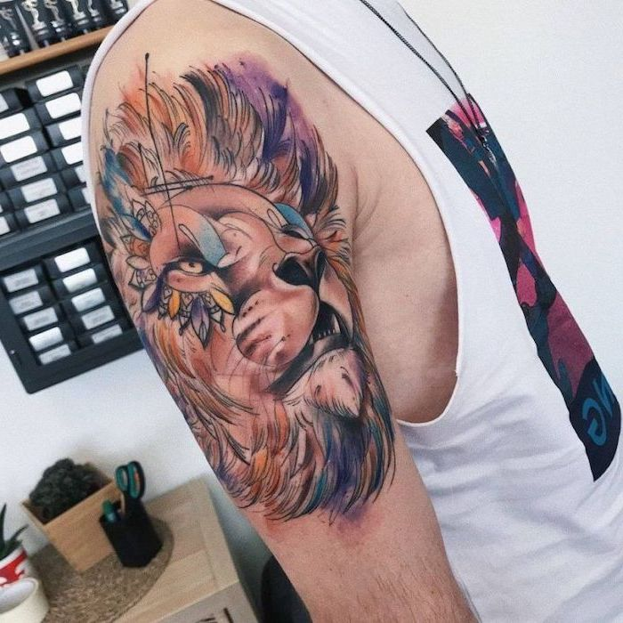 lion head with large mane, watercolor tattoo, lion tattoo on arm, shoulder tattoo in different colors