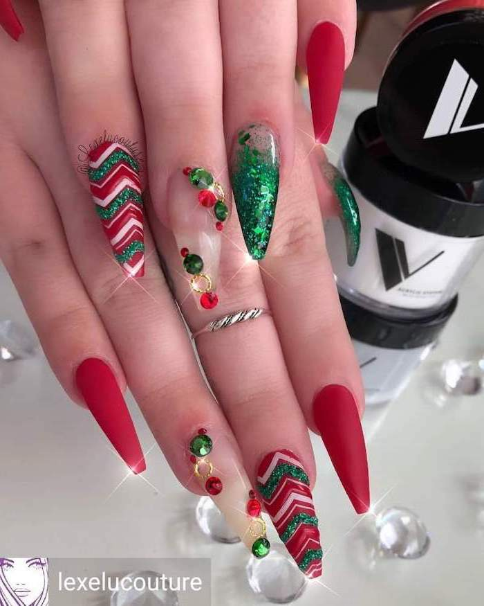 red matte nail polish, green glitter nail polish, winter nail designs, rhinestones and different decorations on each nail