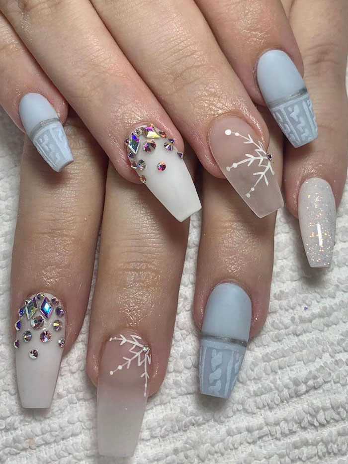 long coffin nails, cute nail colors, blue and white nail polish, different decorations with rhinestones on each nail