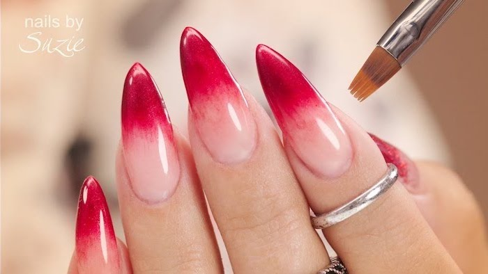 nude to red gradient nail polish, long stiletto nails, pink ombre nails, rings on the index and middle finger