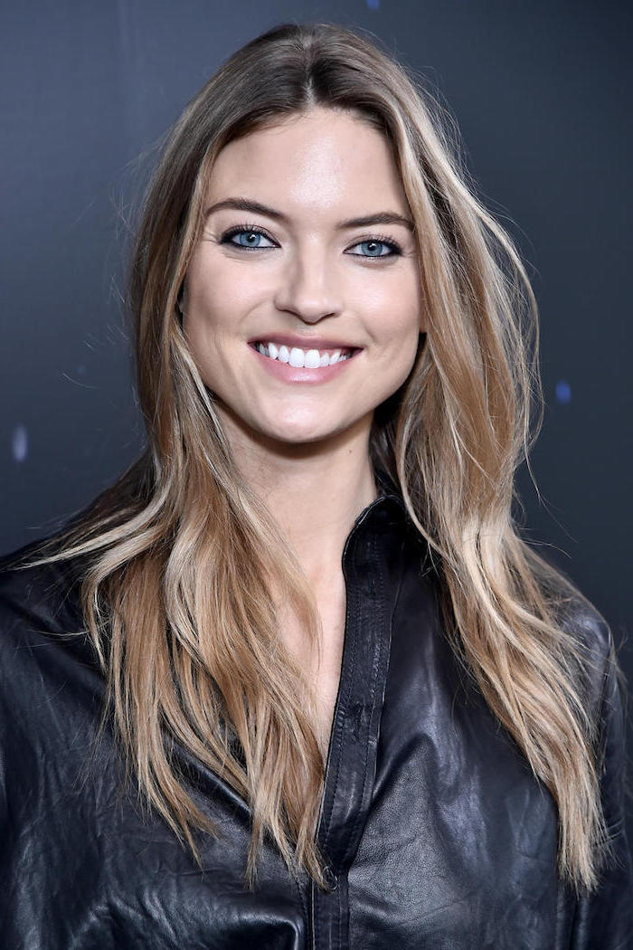 fall blonde hair, martha hunt victoria's secret angel, wearing black leather shirt, balayage brown hair with blonde highlights