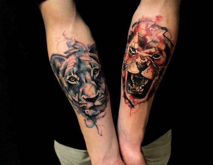 tattoos on both forearms, lion head in red, lioness head in blue, watercolor tattoos, tribal lion tattoo, black background