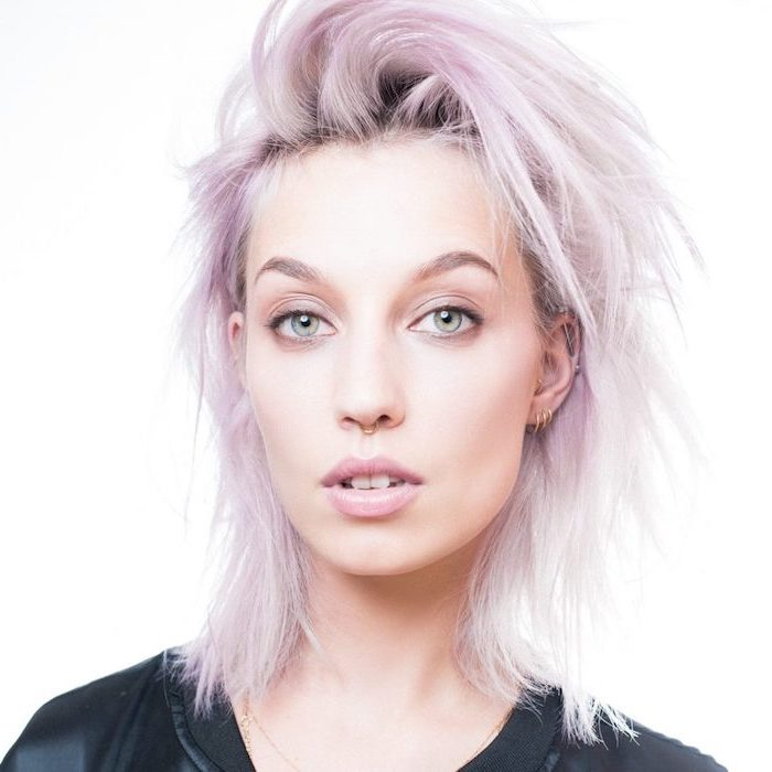 curly hair color ideas, shoulder length straight bob, woman with light purple hair, wearing black shirt