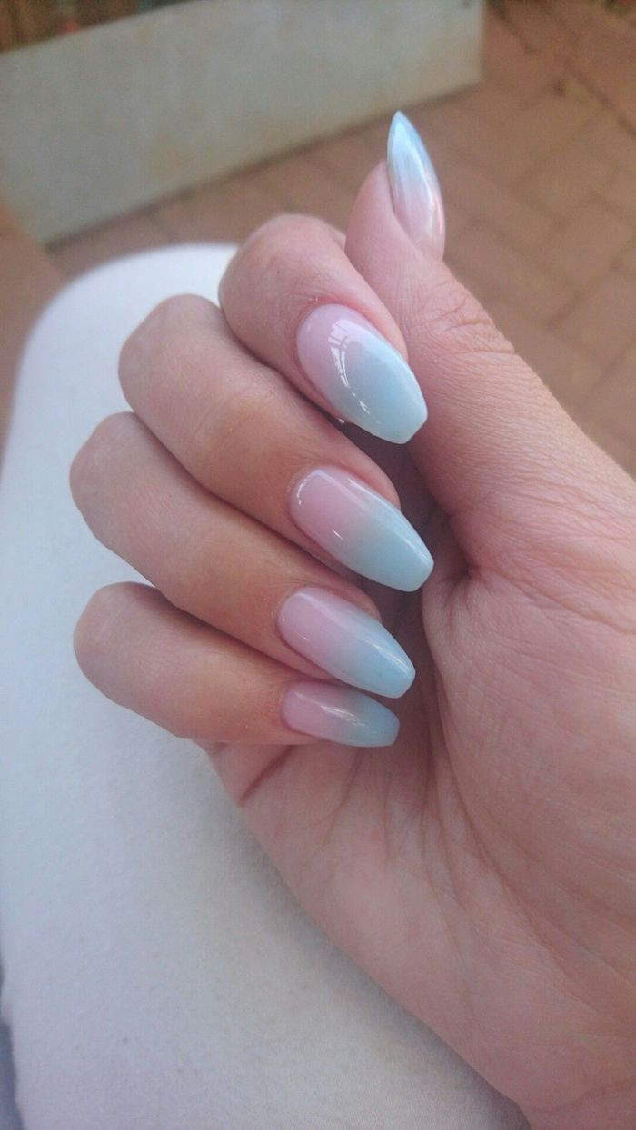 pink to blue gradient nail polish, pink ombre nails, female hand leaning on white surface, with long coffin nails
