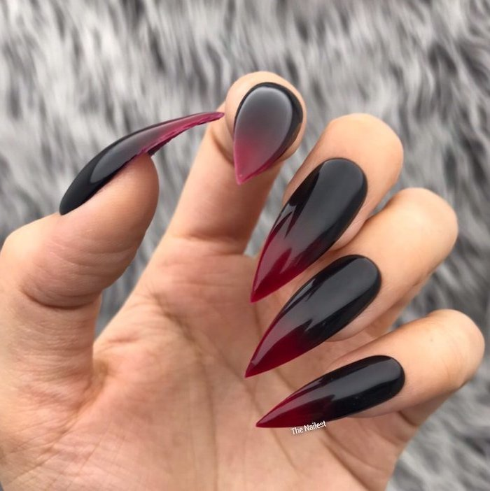 black to red gradient nail polish, extra long stiletto nails, blue ombre nails, blurred background